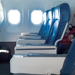 a row of aircraft seats treated with flame retardant products